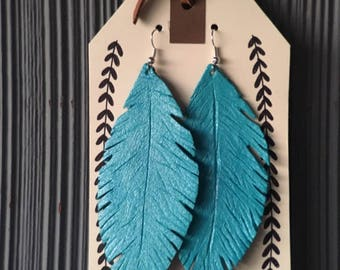 Turquoise hand cut and hand carved leather feather earrings