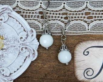 White glass bead earrings.