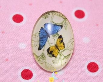 Glass cabochon oval pattern blue and yellow butterflies 18 / 25mm