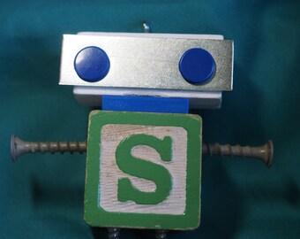 "Mini Bot, letter ""S"", mixed media robot sculpture"
