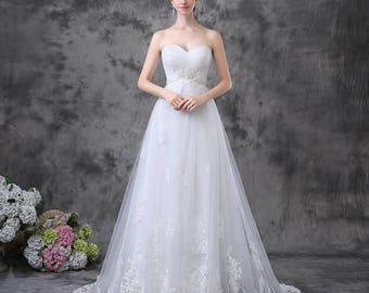 Sweetheart strapless pleated tulle A-line gown with lace appliques