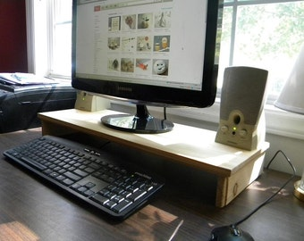 Computer monitor/tv stand organizing station . slide the keyboard under when you need more work space