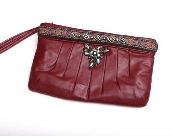 The Rasberry beret clutch bag
