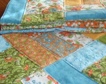quilted patchwork large square placemats, orange, turquoise, greens, browns