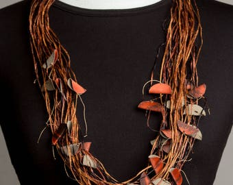 contemporary fiber jewellry, multi-strand silken straw yarn necklace, hand dyed yarn necklace, earth tones necklace