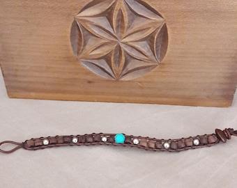 Bracelet with turquoise imitation.