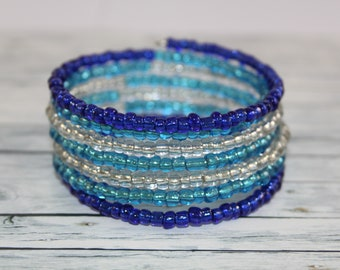 Transparent blue and white glass beads memory wire bracelet
