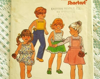 Childrens Top Shorts Pants Skirt and Jumper Butterick 6557 Sewing Pattern Size 6 and 6X CUT