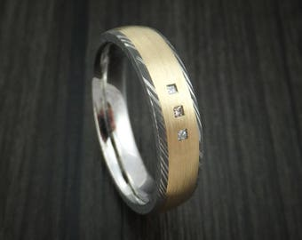 Damascus steel and 14k yellow gold ring with diamonds custom made band