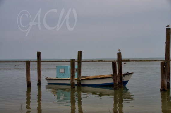 One of many traditional Apalachicola Oyster Boats Moored at East Bay Florida (canvas)