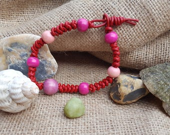 Red braided leather bracelet with various shades of pink beads.
