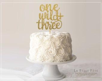 ONE, WILD + THREE gold glitter cake topper