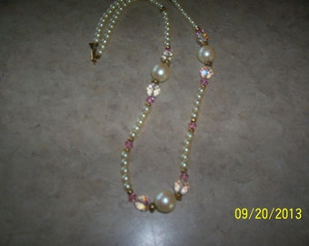 Necklace, pearl like and crystal like beads