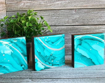 Aqua current | Original abstract art painted on yupo paper, mounted on 7/8 inch cradled wood panel | Set of three, 4x4 | Aqua blue & silver