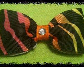 Multi Color Zebra Bow. Orange & Bling center.
