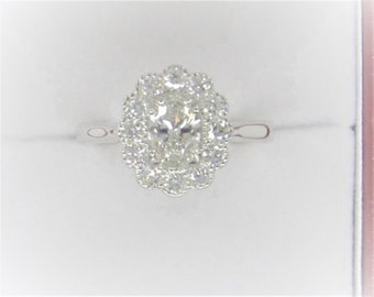Exquisite GIA Certified Oval Diamond Classic Cluster Ring
