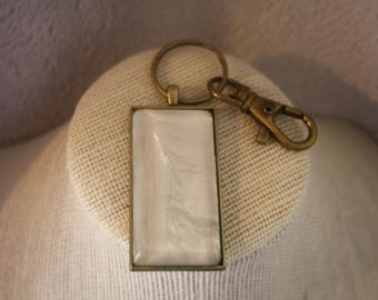 Mother of Pearl (look) and antique brass key chain.