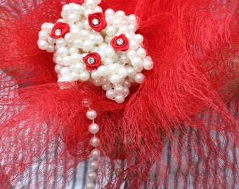 Handmade red webbing and pearl bouquet