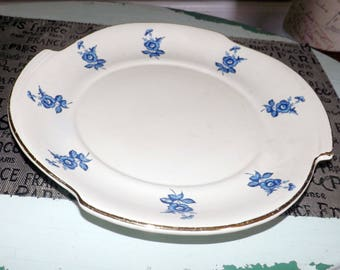 Mid-century (1950s) California Originals | Cal Orig 852 round, lugged | handled platter.  Made in USA. Blue & white flowers.