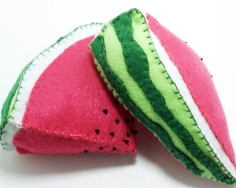 Two slices of watermelon plush toys