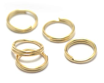 50 closed rings doubled, gold plated 8 mm