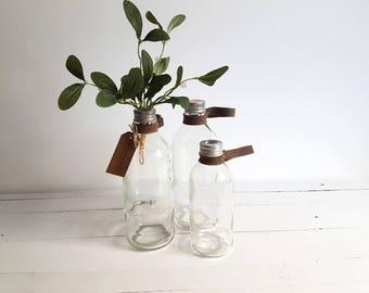 Vintage glass medical infusion bottle / vase