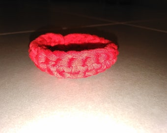 Red bracelet made with recycled cotton