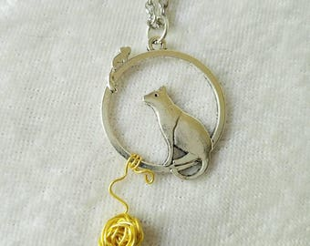 A Round of Cat and Mouse Silver Necklace with Gold yarn ball