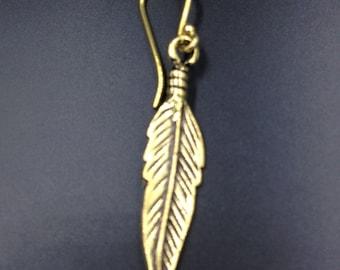 Little feather brass earrings.
