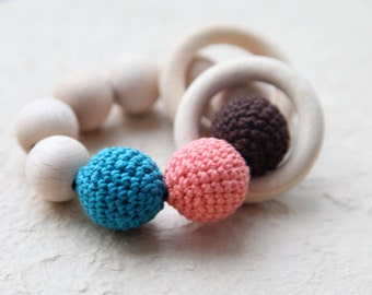 Teething toy with crochet chocolate, coral and teal wooden beads and 2 wooden rings. Wooden rattle. Gift for baby and mum.