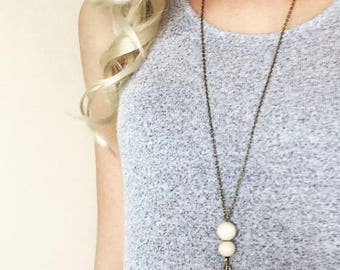 Long bronze boho necklace - Bronze feather charm & natural wooden beads