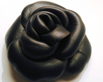 Black lamb leather brooch