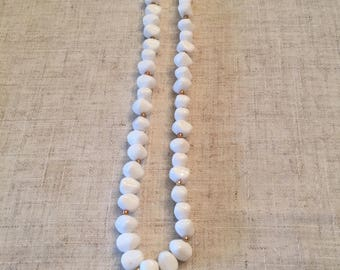 Vintage white necklace with gold accent beads