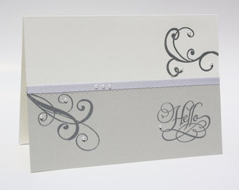 An elegant greeting card in silver and pearls to say hello