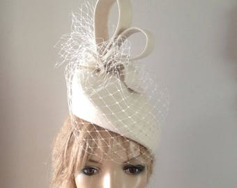 ivory wool felt perching hat adorned with sculptured loops &merry widow veiling.