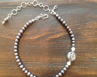 Purple freshwater pearls with tribal silver accent bead and sterling silver clasp