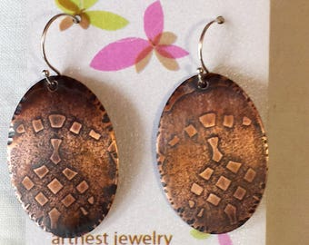 Oval dangle earrings with patina and abstract texture
