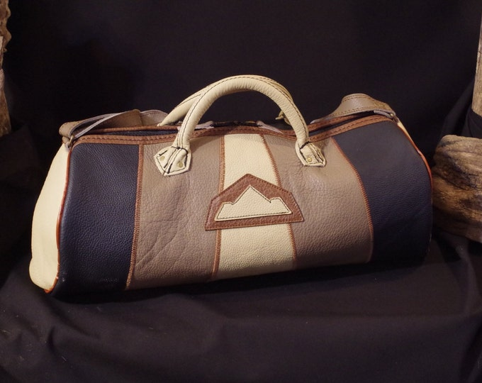patchwork of black leather, beige, taupe and Brown duffel bag