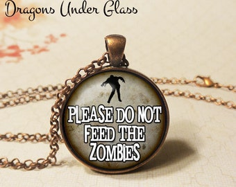 """Please Do Not Feed The Zombies Necklace - 1-1/4"""" Circle Pendant or Key Ring - Wearable Photo Art Jewelry - Ghoul, Halloween Costume Horror"""