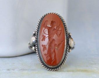 VINTAGE FIND, Art Deco style sterling silver ring with vintage deep red hand carved jasper Cupid cameo. antique silver ring