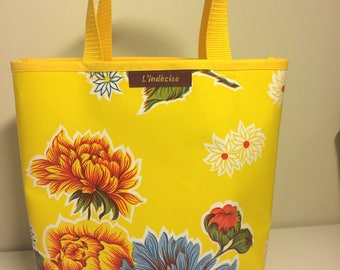 small yellow oilcloth tote bag