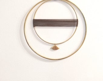 Elegant and delicate modern brass wall hanging