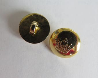 Gold vintage button adorned with a Crown