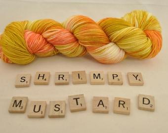 "Hand-dyed yarn, ""Shrimpy Mustard"" variegated, soft and squishy yarn. Great for socks or shawls. 80/20/ Superwash wool/Nylon"