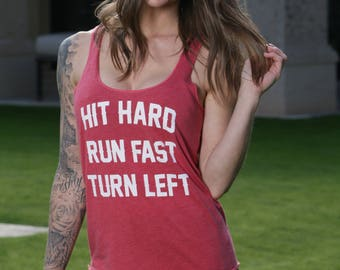 Hit Hard Run Fast Turn Left. Slouchy Racer Tank. Made in the USA. 8 Colors to Choose From. Baseball Tank. Team Gear Tank Top.