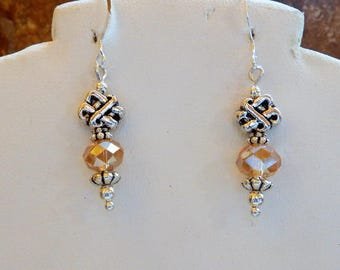 Silver Celtic Knot earrings with Champagne colored Crystals