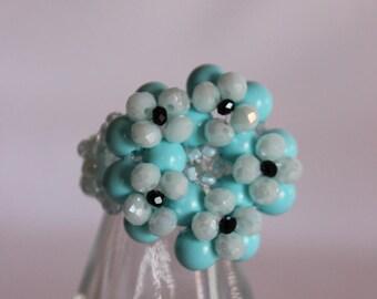 Maxi ring of blue crystals and semiprecious.