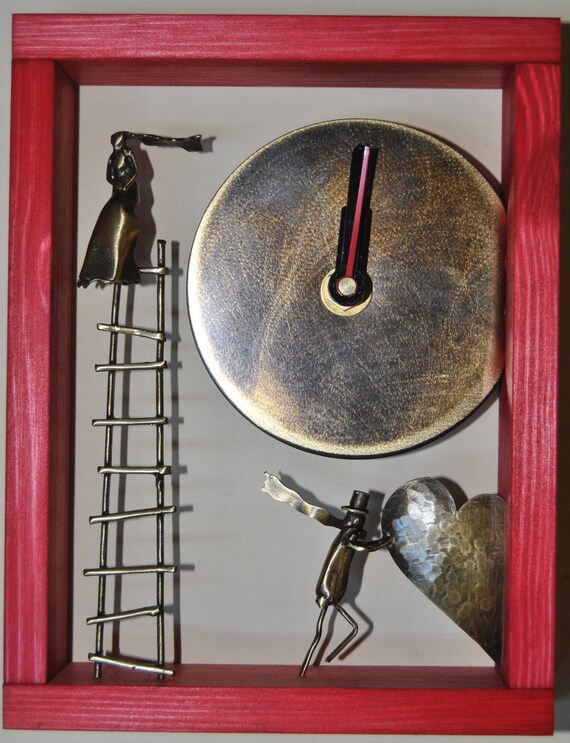Deep red wooden clock with a ladder and two brass figures.