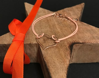 Beautiful Open Rose Gold Heart on a pale coral leather bracelet