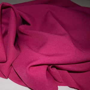Raspberry or Dark pink 1Gabardine 100% Polyester. Shipping  6.00 first yard all others 1.50. Free swatches available upon request